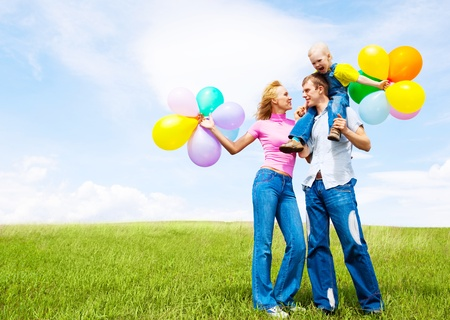 happy family with balloons outdoor on a summer day Stock Photo