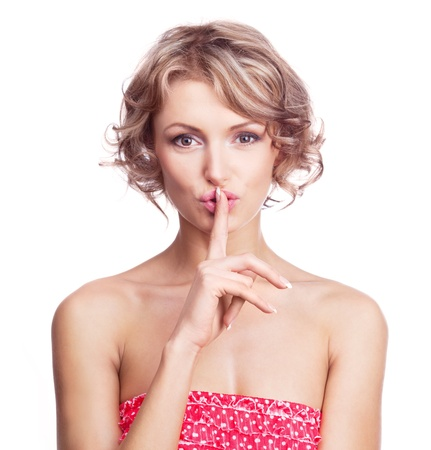 beautiful young woman with her finger near her lips (a sign of being quiet- hush) Stock Photo - 9394178
