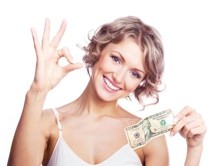 happy rich woman: Beautiful young woman holding soldi e che ci mostra il segno OK Archivio Fotografico
