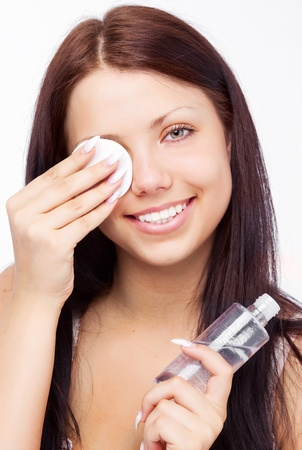 beautiful young brunette woman removing makeup cotton pads Stock Photo - 9424878