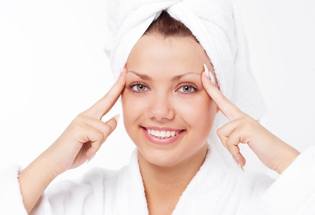 beautiful young woman wearing a towel and a white bathrobe making herself a Temple-Massage photo