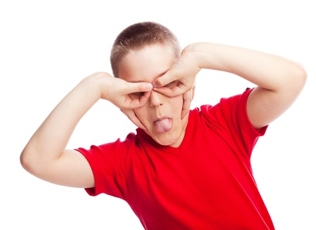misbehave: happy ten year old boy making faces, isolated against white Stock Photo