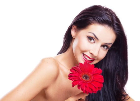 sexy young brunette woman with a red flower, isolated against white background photo