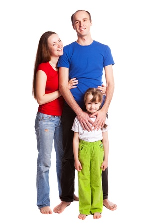 happy young family; mother, father and their daughter isolated against white background Stock Photo - 9613902