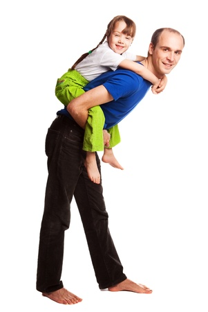 happy family; young father giving a piggyback ride to his daughter. isolated against white backgorund Stock Photo - 9613796