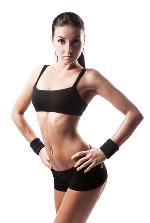 female bodybuilder: beautiful young sporty muscular  woman, isolated against white background