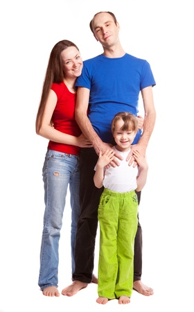 happy young family; mother, father and their daughter isolated against white background (focus on the child) Stock Photo - 9617625