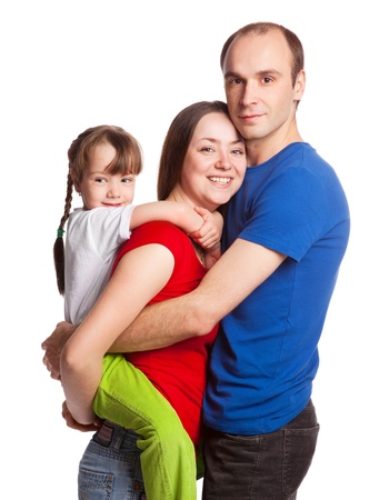happy young family; mother, father and their daughter isolated against white background (focus on the woman) Stock Photo - 9617628