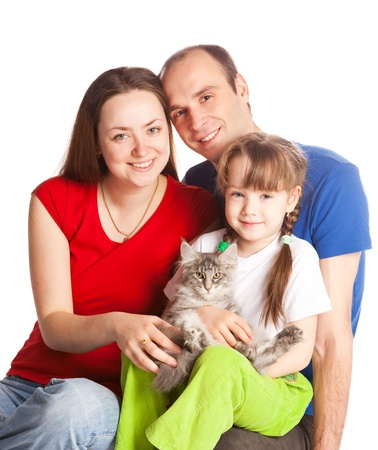 happy young family; mother, father, their daughter and a cat isolated against white background (focus on the child) photo