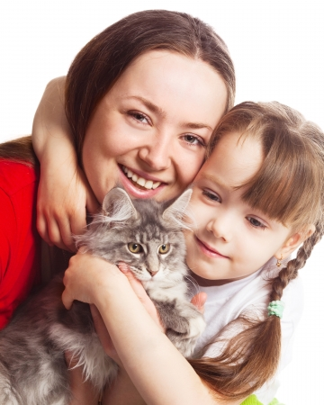 happy young family; mother, her daughter and a cat isolated against white background photo