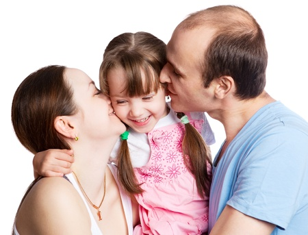 happy young family; mother, father and their daughter isolated against white background Stock Photo - 9617676