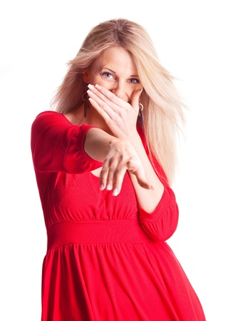 beautiful  smiling blond girl pointing at us with a finger and laughing, isolated against white background Stock Photo - 9617960