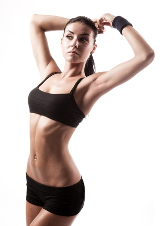 muscular woman: beautiful young sporty muscular  woman, isolated against white background