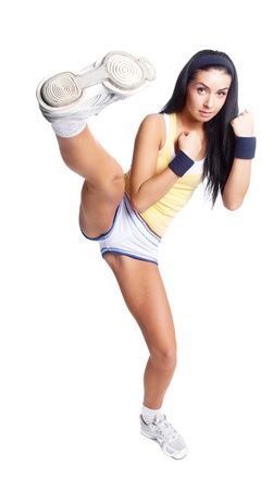 fighting styles: beautiful young brunette woman wearing sports clothes,  practicing fighting