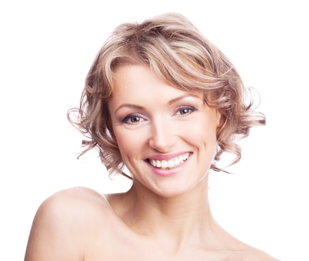 pretty young blond woman with curly hair, isolated against white photo