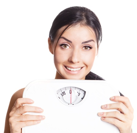 check out: beautiful young brunette woman  holding scales  Stock Photo
