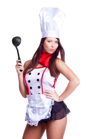 sexy food: sexy brunette cook wearing uniform and holding a spoon, isolated against white background Stock Photo