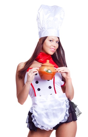 sexy brunette cook wearing uniform and holding a  pot, isolated against white background Stock Photo - 9756874