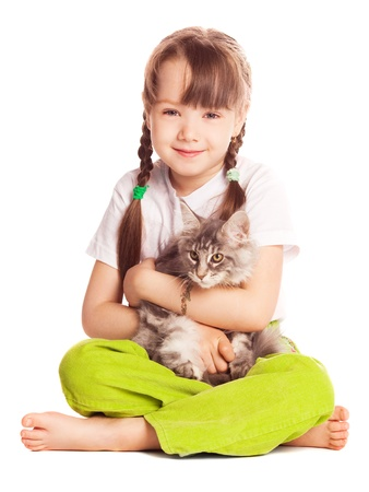 sit: happy cute five year old girl  with her cat, isolated against white background