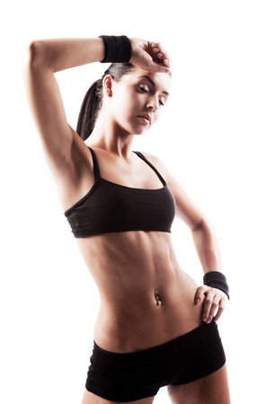 perfect fit: beautiful young sporty muscular  woman, isolated against white background