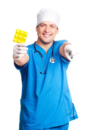 portrait of doctor wearing a  blue uniform and giving us pills. isolated on white background photo