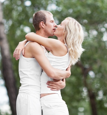 happy kissing couple spending time outdoor on a summer day Stock Photo - 10026558