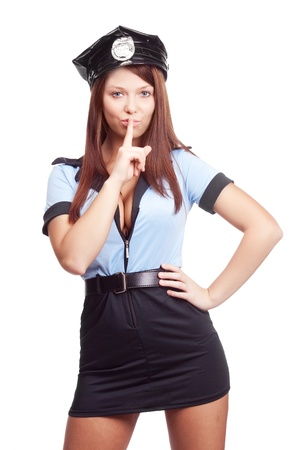 young policewoman, telling us to be silent, isolated against white background