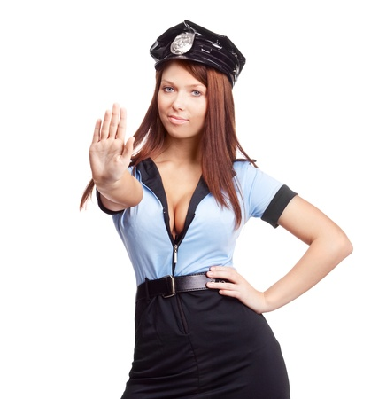 mujer policia: joven polic�a sexy, dici�ndonos que detener, aislado sobre fondo blanco