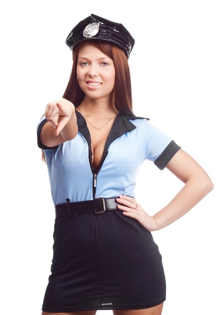 young sexy policewoman pointing at us and smiling, isolated against white background photo