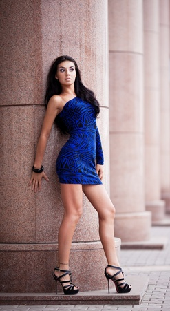 outsides: very beautiful young brunete woman wearing a mini dress in the street