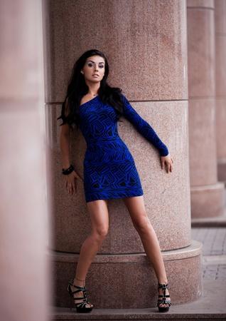 brunete: very beautiful young brunete woman wearing a blue mini dress in the street