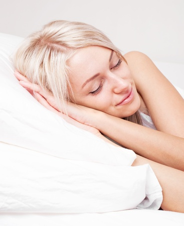 girl bed: beautiful young blond woman on the bed at home Stock Photo