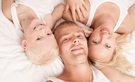 happy family; mother ,father and their son in  bed at home  Stock Photo - 10088535
