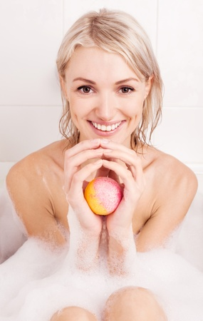 beautiful young blond woman taking a bath and using an aromatized geyser Stock Photo - 10089516