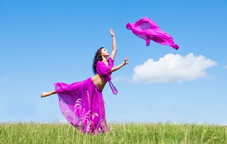 happy dancing young woman  outdoor on a summer day photo
