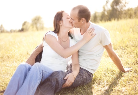 happy young couple spending time outdoor on a summer day at sunset photo