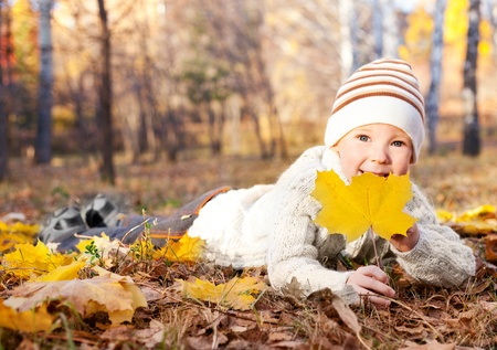 outsides: happy little boy spending time outdoor in autumn the park  Stock Photo
