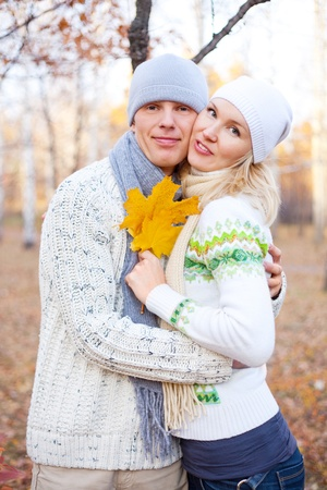 happy young couple spending time outdoor in the auatumn park  photo