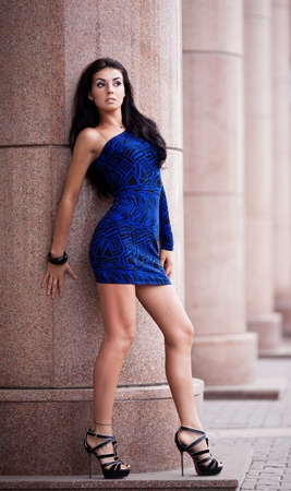 appealing attractive: very beautiful young brunete woman wearing a blue mini dress in the street