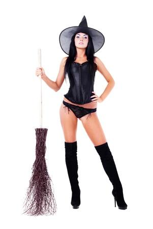 Mooie sexy jonge brunette heks met een bezem, geïsoleerd tegen een witte achtergrond Stockfoto - 10439848