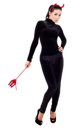 evil girl: sexy brunette girl wearing a halloween costume of an imp Stock Photo