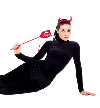 devil woman: sexy brunette girl wearing a halloween costume of an imp Stock Photo