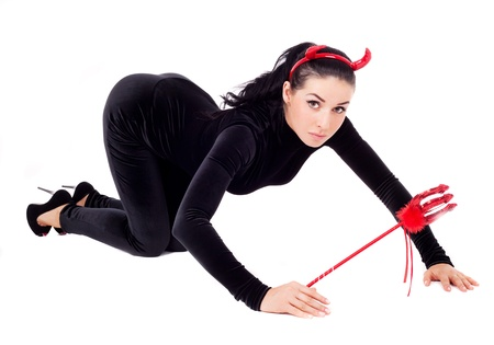sexy brunette girl wearing a halloween costume of an imp photo