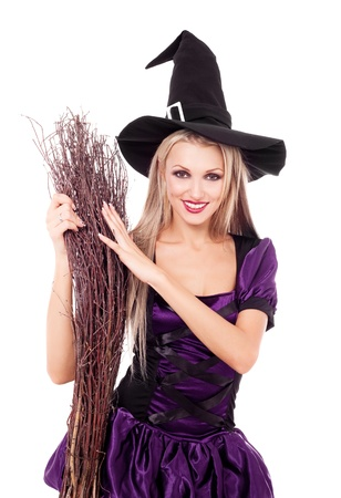 pretty sexy young blond witch with a broom, isolated against white background photo