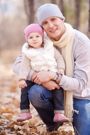 happy young father with his daughter spending time outdoor in the autumn park Stock Photo - 10794787