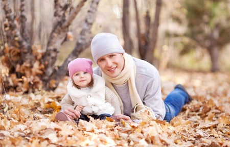 happy young father with his daughter spending time outdoor in the autumn park Stock Photo - 10794752