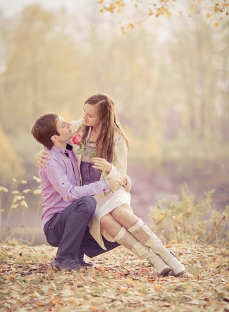 tender passion: low contrast image of a happy romantic young couple spending time outdoor in the autumn park   Stock Photo