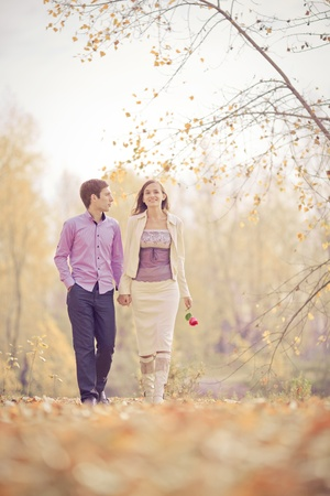 low contrast image of a happy young couple spending time outdoor in the autumn park Stock Photo - 10794743