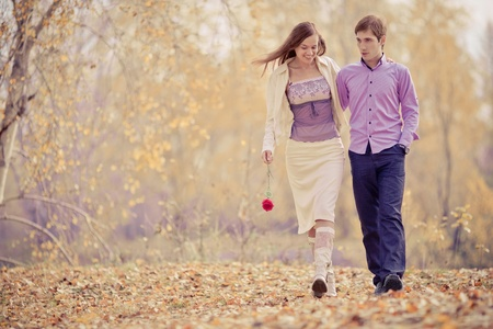 romantic kiss: low contrast image of a happy romantic young couple spending time outdoor in the autumn park   Stock Photo