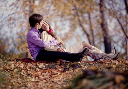 outsides: happy romantic young couple spending time outdoor in the autumn park  Stock Photo